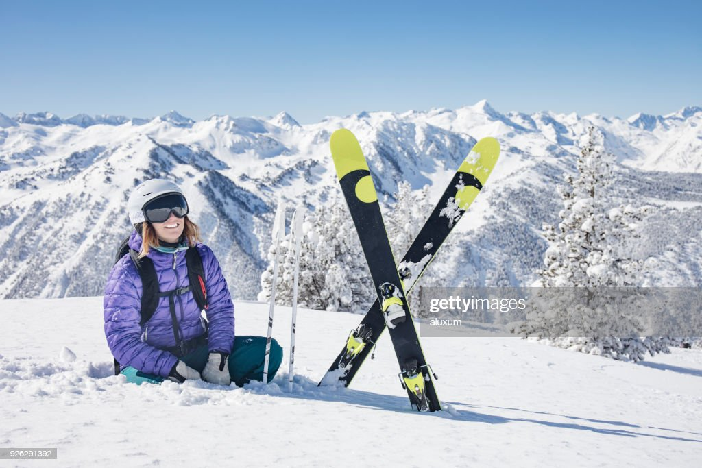 Woman taking a break on a backcountry skiing day : Foto stock