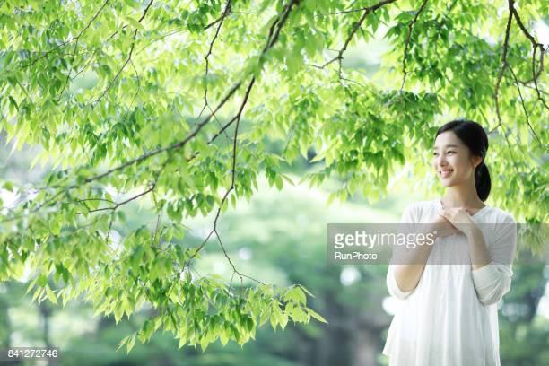 woman taking a break under a tree