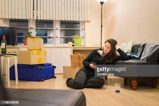 woman taking a break while moving house - individual event stock pictures, royalty-free photos & images