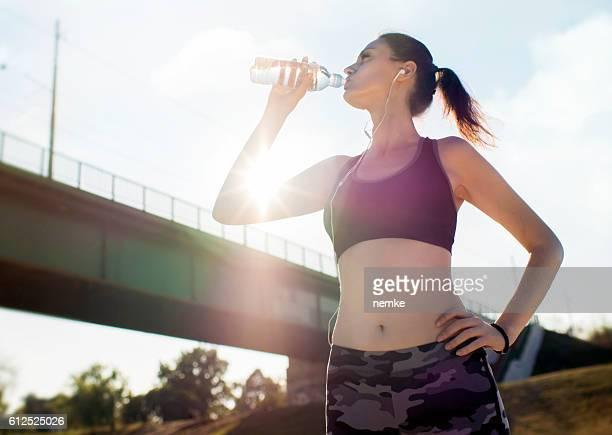 Woman taking a break with water bottle drink outside
