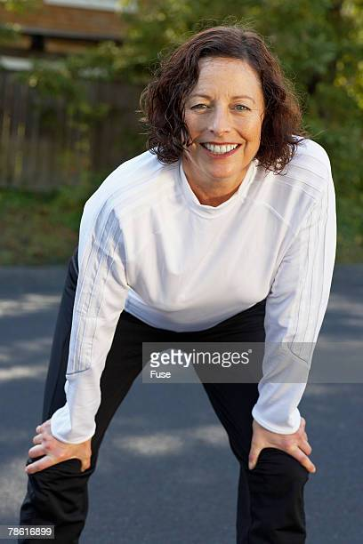 woman taking a breather - older woman bending over stock pictures, royalty-free photos & images