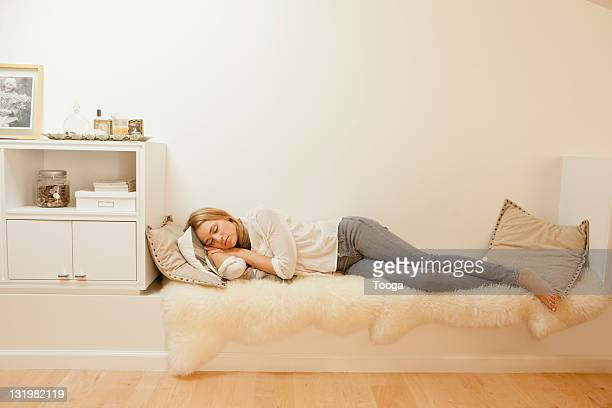 Woman taking a nap in nook of home