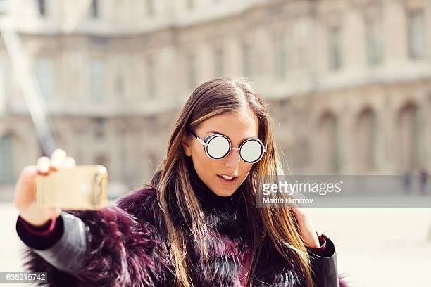 Woman taking a photo in Paris