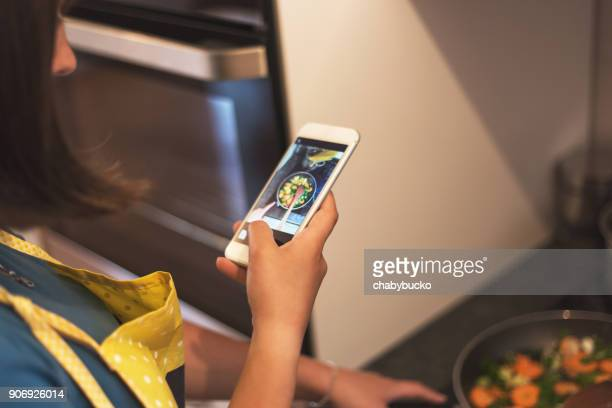 woman taking a photo of healthy food - photo messaging stock pictures, royalty-free photos & images