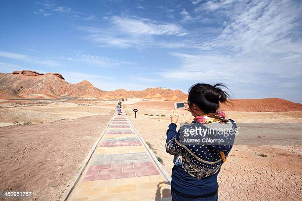 Woman taking a photo of landscape in China