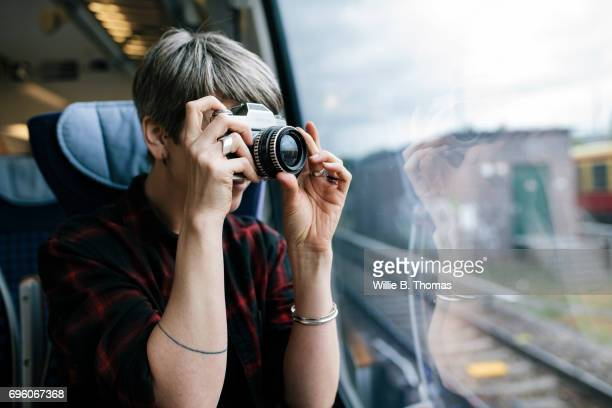 A Woman Taking A Photo On A Train Journey