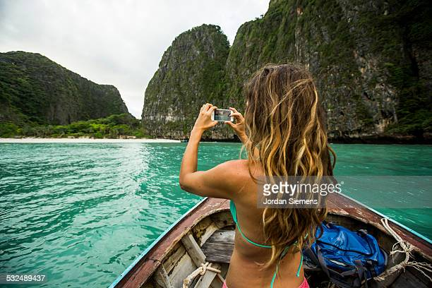 A woman taking a photo with her iPhone.