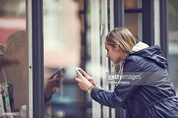 Woman taking a photo with smartphone