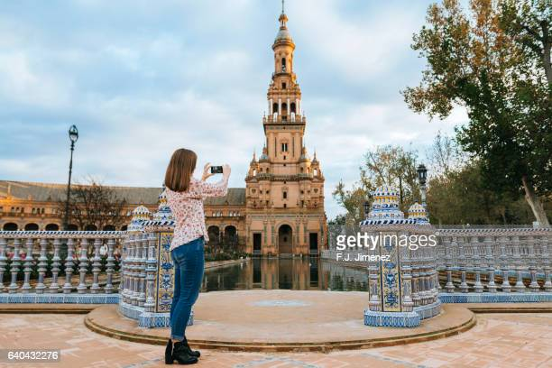 woman taking a photograph - capturing an image stock pictures, royalty-free photos & images
