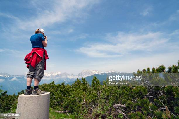 woman taking a picture from top of land - moment of silence stock pictures, royalty-free photos & images