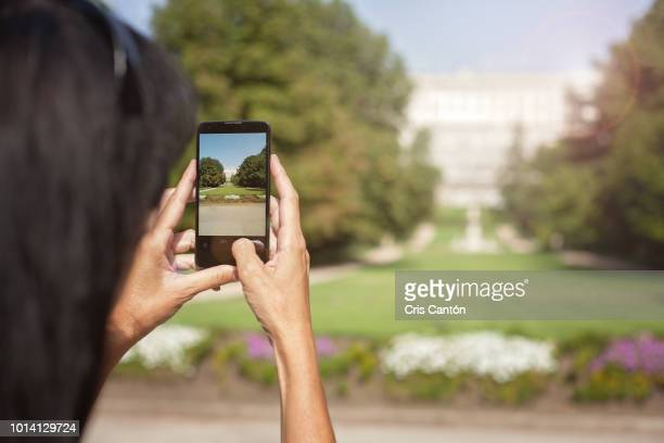 woman taking a picture in madrid - cris cantón photography stock pictures, royalty-free photos & images