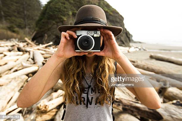 A woman taking a picture.