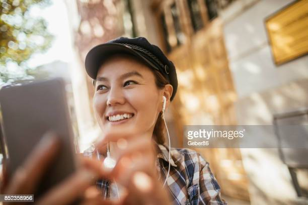 woman taking a picture - photo messaging stock pictures, royalty-free photos & images