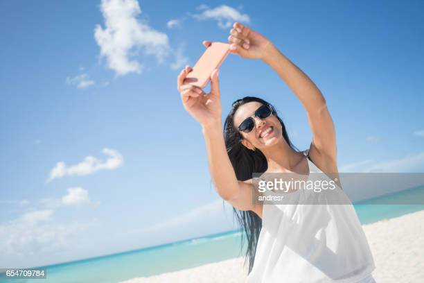 Woman taking a selfie at the beach
