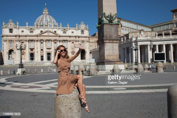 woman taking a selfie in deserted st. peter's square, rome, italy - italy stock pictures, royalty-free photos & images