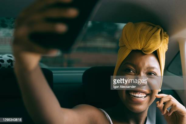 woman taking a selfie in the car - turban stock pictures, royalty-free photos & images