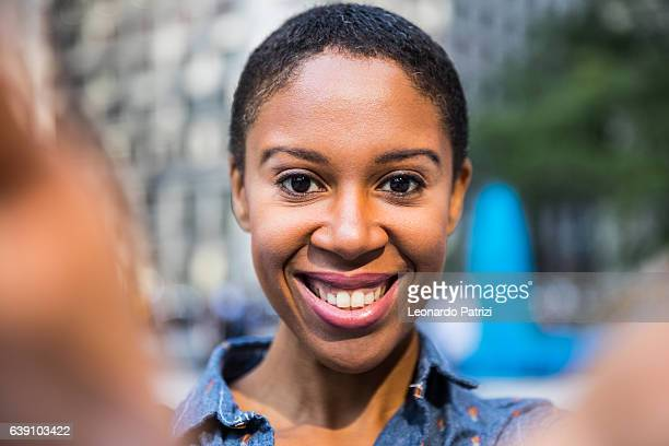 Woman taking a selfie in the streets in Chicago