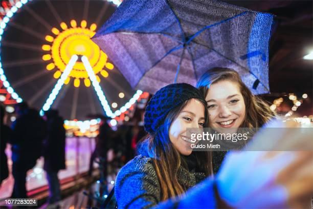 Woman taking a selfie on christmas market.
