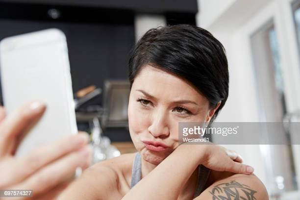 Woman taking a selfie pouting
