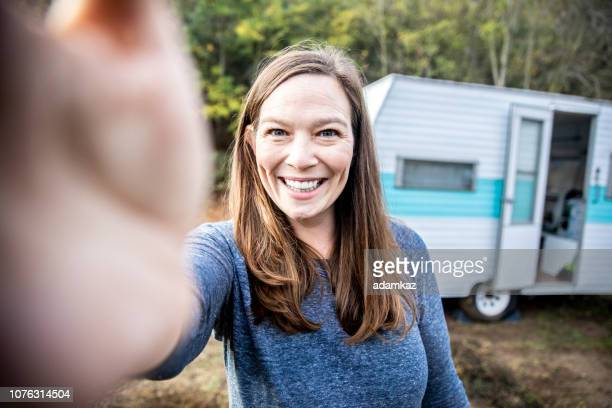 Woman taking a selfie whiel camping