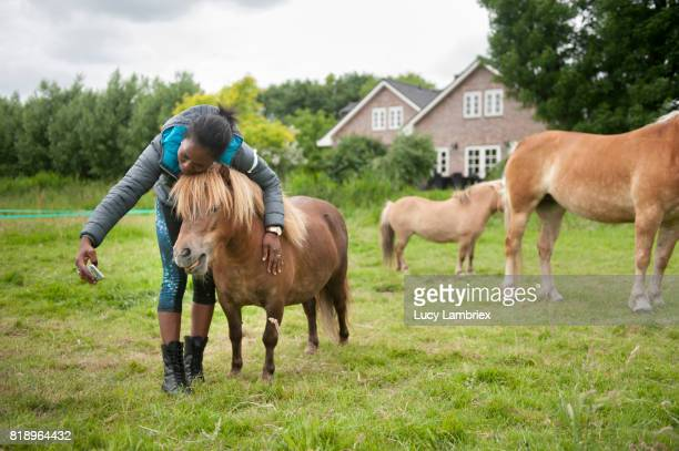 Woman taking a selfie with a pony