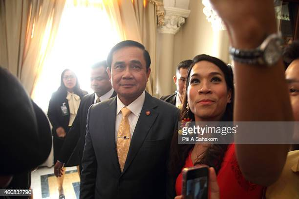 A woman taking a selfie with Prime Minister Prayut Chanocha after he finished delivering a statement on the government's 3 months work...