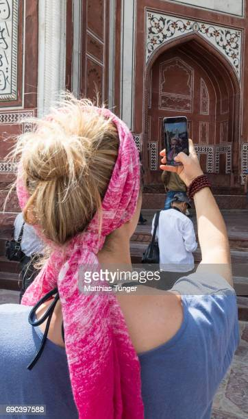 woman taking a selphy on a tour at the Taj Mahal