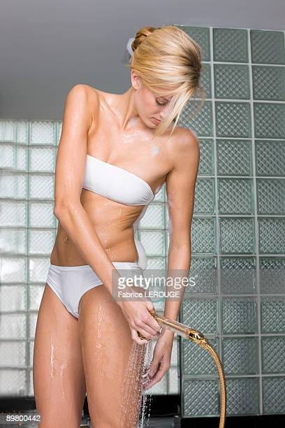 woman taking a shower - wet knickers stock pictures, royalty-free photos & images
