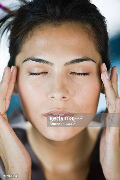 woman taking a spa treatment - pressure point stock photos and pictures