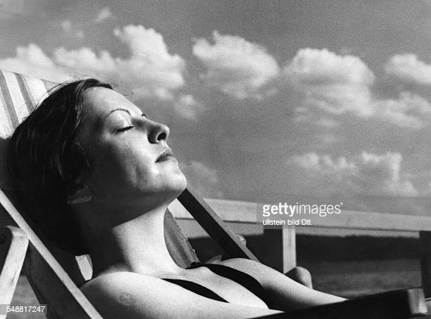 Woman taking a sunbath ca 1936 Photographer Artur Grimm Published by 'Sieben Tage' 24/1936 Vintage property of ullstein bild