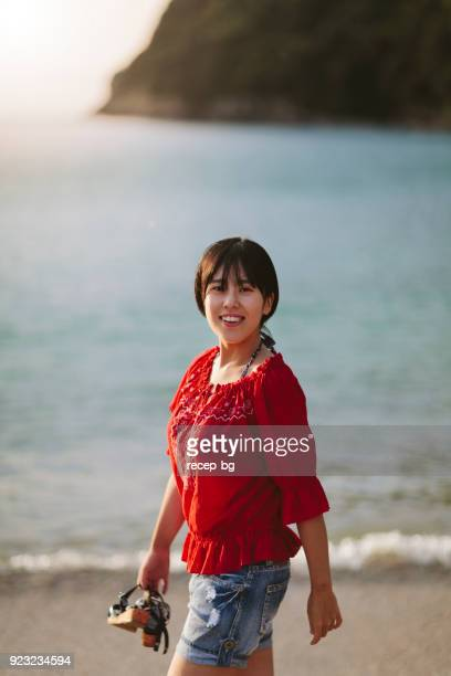 Woman taking a walk at beach in morning