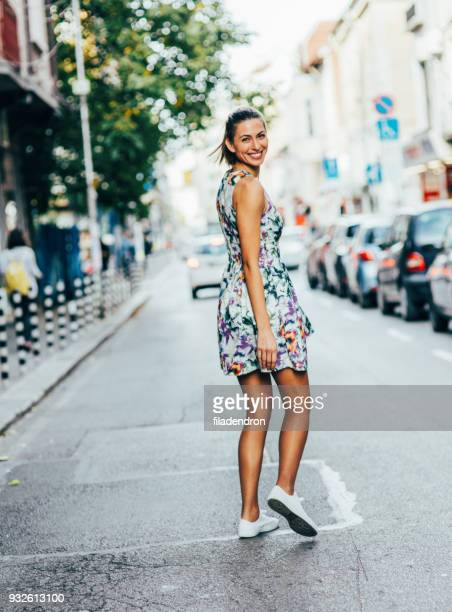 woman taking a walk in the city - dress stock pictures, royalty-free photos & images