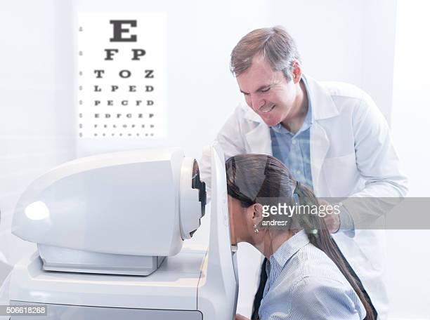 Woman taking an eye exam