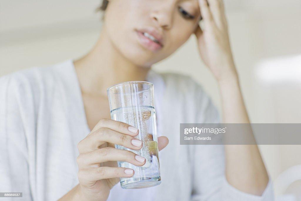 Woman taking antacid : Stock Photo