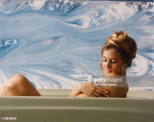 Woman taking bath, close-up