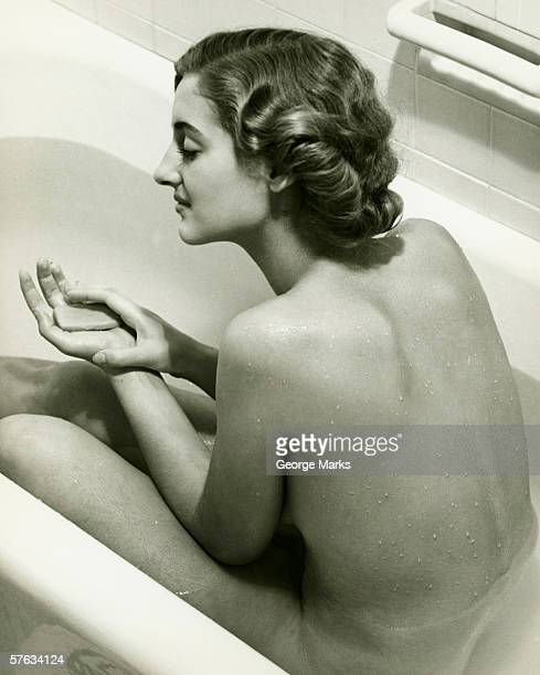 Woman taking bath, (B&W)
