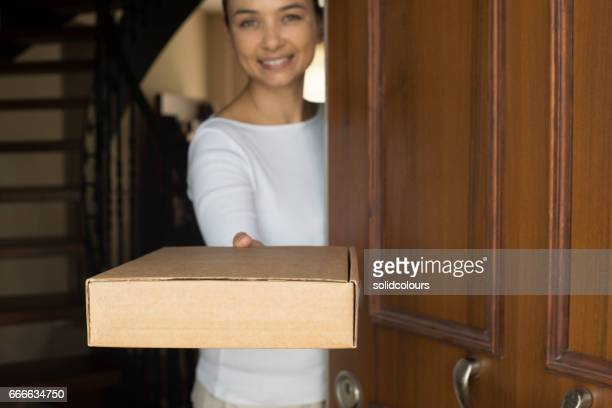 Woman Taking Box