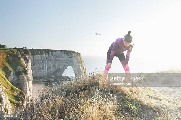 Woman taking break during running near sea