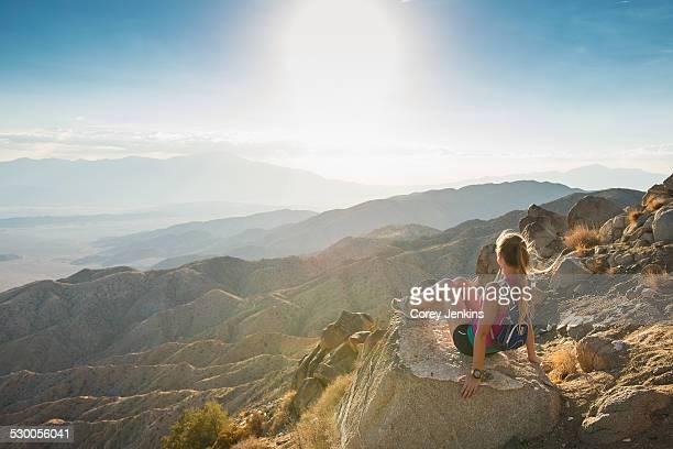 Woman taking break on mountain, Joshua Tree National Park, California, US