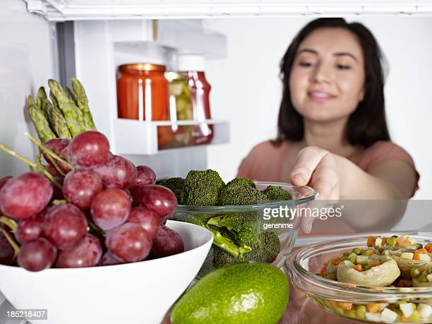 Woman Taking Broccoli