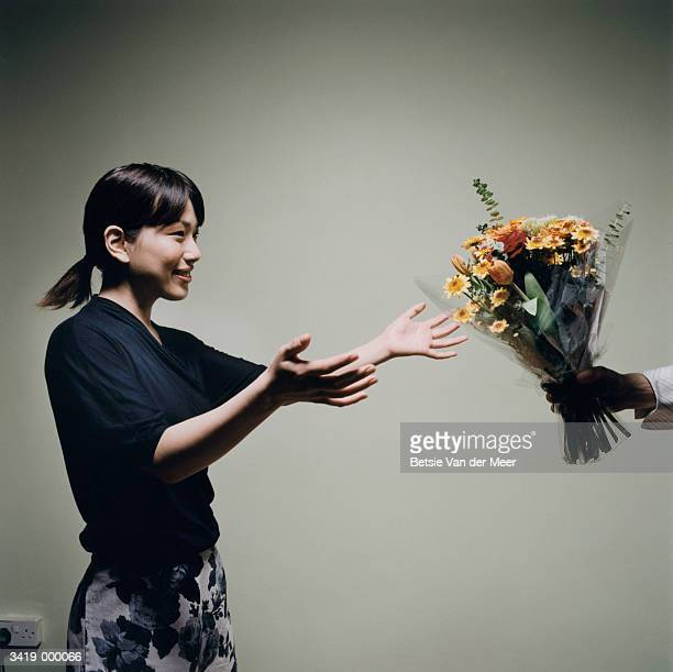 Woman Taking Bunch of Flowers