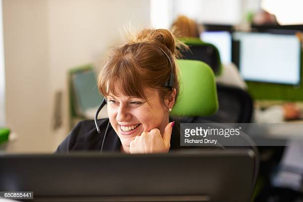 woman taking call  in call centre - call center stock pictures, royalty-free photos & images