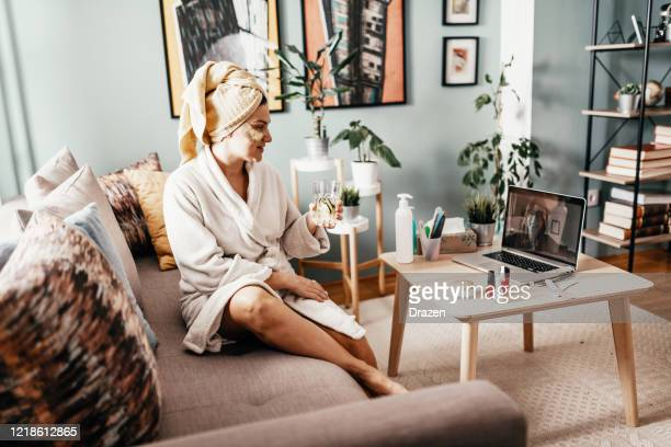 woman taking care of her beauty during stay at home period - body care stock pictures, royalty-free photos & images