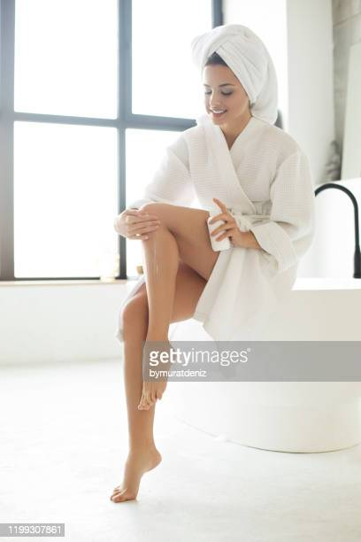 woman taking care of her body after bath - human leg stock pictures, royalty-free photos & images