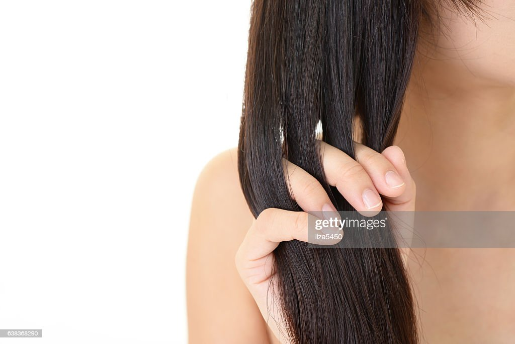 Woman taking care of her hair : Stock Photo