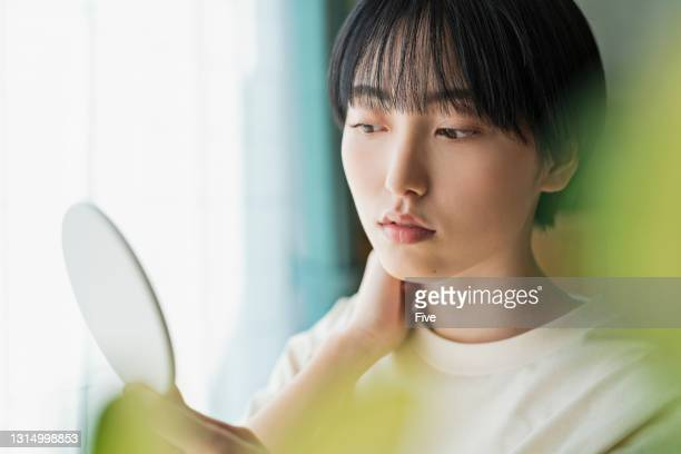 a woman taking care of her skin - bad student stock pictures, royalty-free photos & images