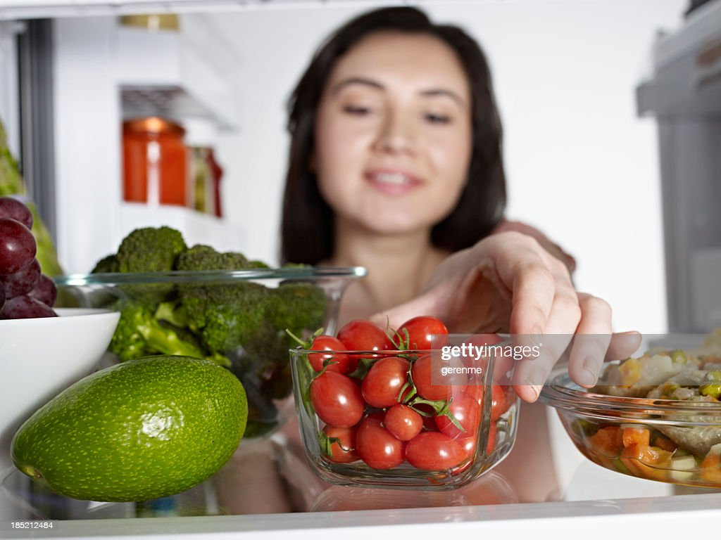 Woman Taking Cherry Tomato : Stock Photo