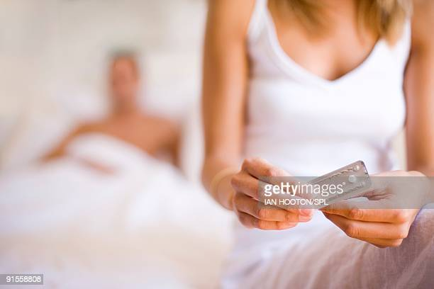 woman taking contraceptive pill - birth control pill stock pictures, royalty-free photos & images