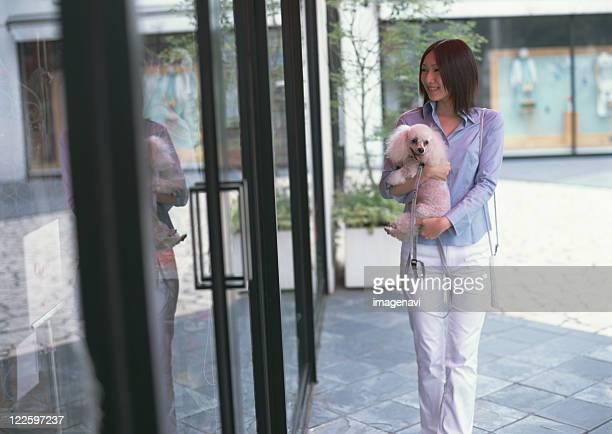 Woman taking dog for walk