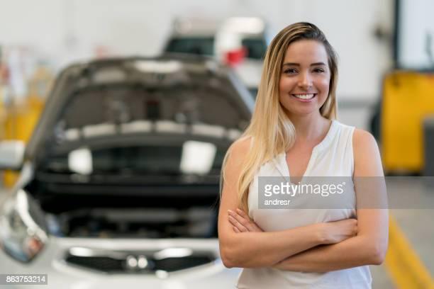 Woman taking her broken car to the mechanic